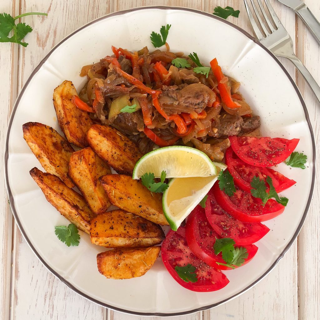 Stir Fried Stake with Onions and Peppers and Oven Roasted Potato Wedges